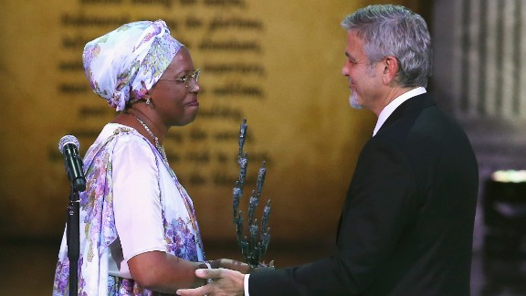 Marguerite Barankitse accepts the inaugural Aurora Prize for Awakening Humanity from George Clooney in Armenia on April 24 2016.
