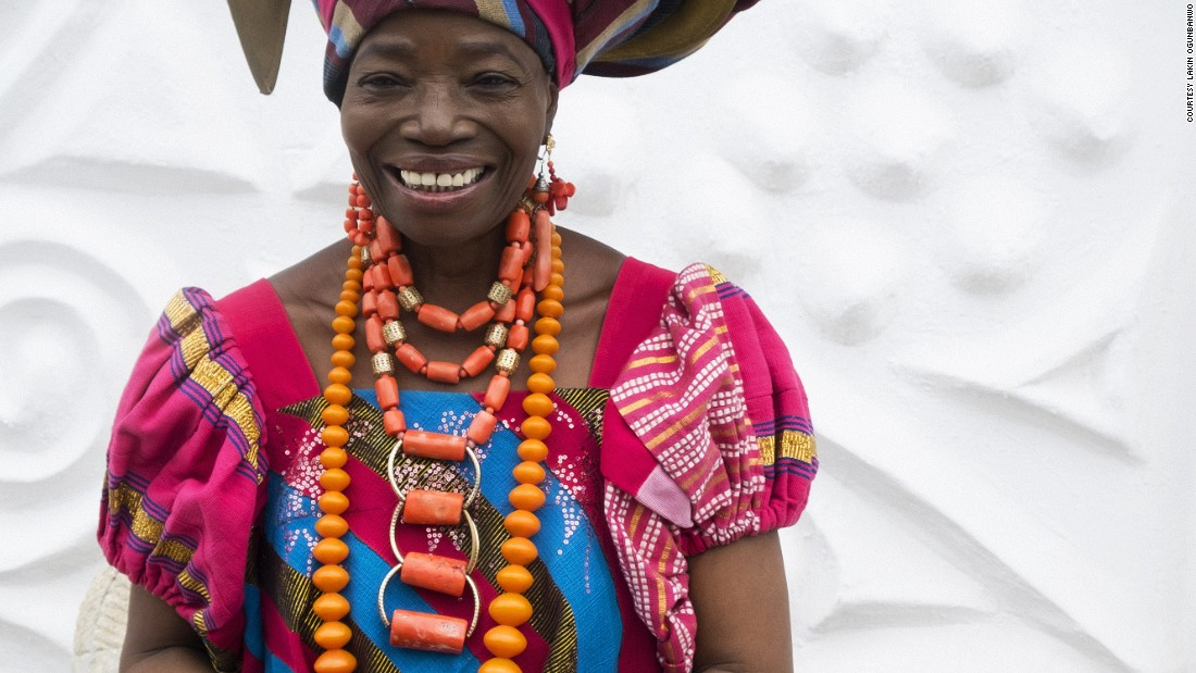 "Africa's most populous city is known for its flamboyancy. ""Wallflowers need not apply"", writes Helen Jennings, journalist and former editor of African fashion magazine Arise. Women mix African and European styles by wearing tailored dresses with the gele, a traditional African head wrap. <br />Pictured: Lagos, Nigeria - Nike Davis Okundaye, Nike Art Centres"