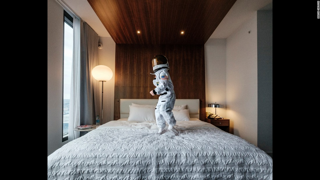 "Sheldon wrote creative captions for each photo that compares his son's experiences to those of real-life astronauts. He called this one, taken at a luxury hotel, ""weightless environment training."" Sheldon said the hotel was Harrison's favorite place to shoot: ""He keeps asking to go back there and take pictures."""