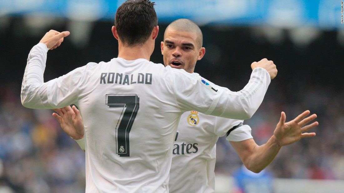Real Madrid's Cristiano Ronaldo is, congratulated by Pepe after scoring the first goal at Deportivo.