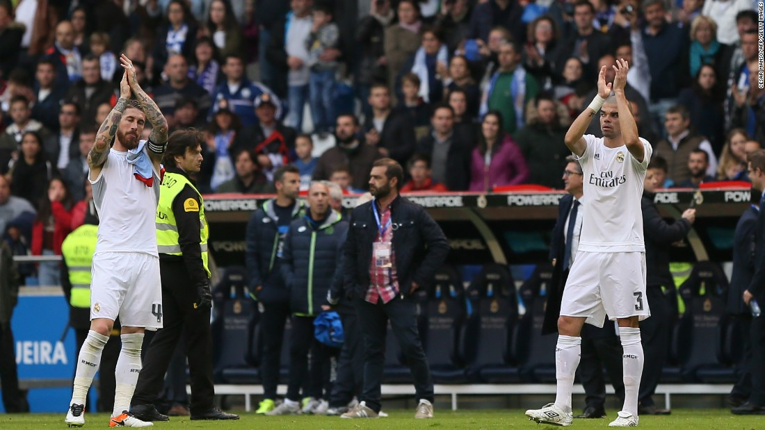 Real Madrid's defenders Sergio Ramos and Pepe applaud their fans at the end of the 2-0 win at Deportiva La Coruna, but their side had to settle for second place in La Liga.