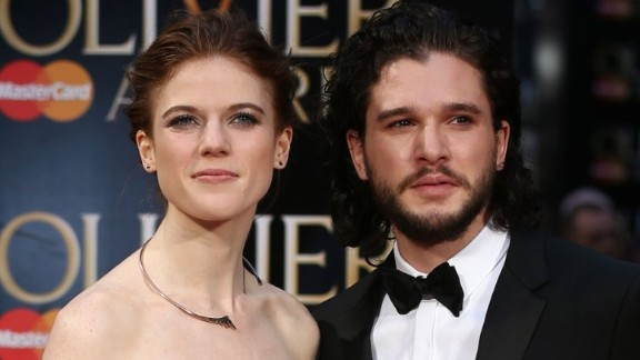 British actor Kit Harington (R) and British actress Rose Leslie (L) pose on the red carpet upon arrival to attend the 2016  Laurence Olivier Awards in London on April 3, 2016. / AFP / JUSTIN TALLIS        (Photo credit should read JUSTIN TALLIS/AFP/Getty Images)