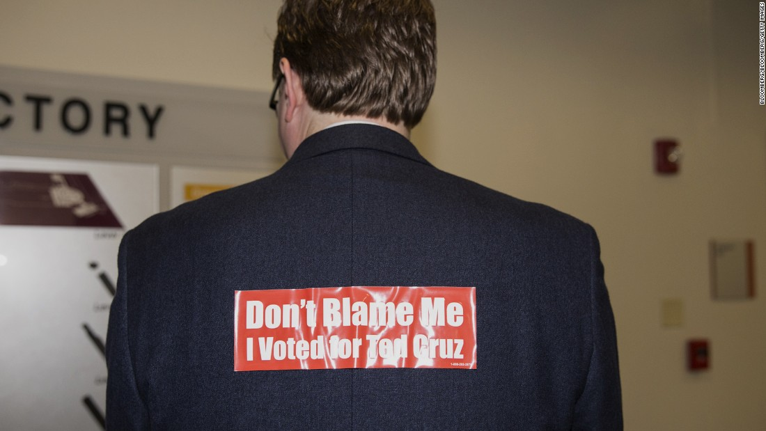 A man wears a bumper sticker during the 2016 Texas Republican Convention in Dallas on Saturday, May 14.