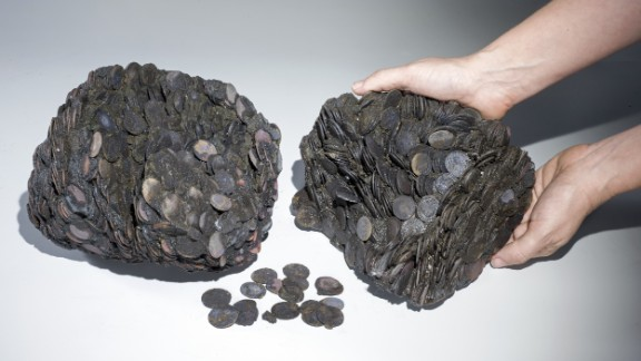 Lumps of coins that were discovered at sea, weighing a total of around 20 kilograms.