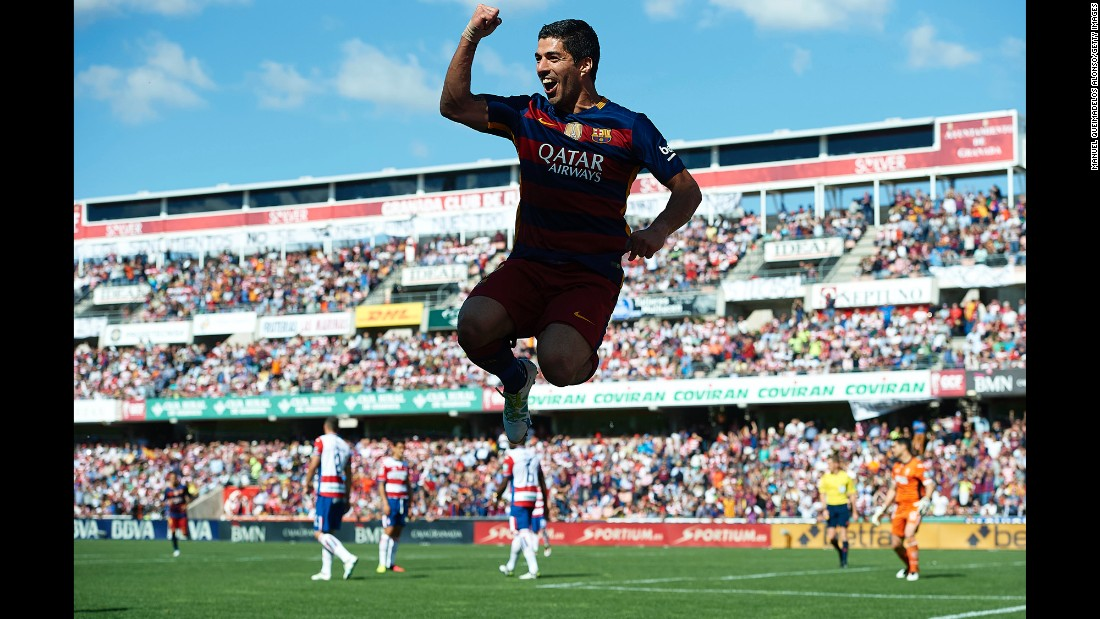 "Barcelona forward Luis Suarez celebrates the second of his three goals Saturday, May 14, in Granada, Spain. His hat trick gave Barcelona the victory it needed <a href=""http://www.cnn.com/2016/05/14/football/football-barcelona-suarez-real-madrid/index.html"" target=""_blank"">to clinch its second straight Spanish league title.</a>"