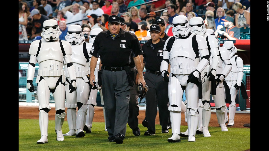 "Umpires are escorted onto the field by ""Star Wars"" stormtroopers before a Major League Baseball game in Phoenix on Saturday, May 14. It was ""Star Wars Night"" at the ballpark."