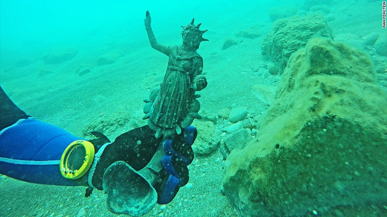 Divers discover ancient treasure trove in shipwreck