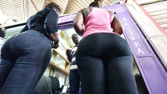 """Women buy bottom enhancer products in a market of Treichville suburb of Abidjan, Ivory Coast, where """"big is beautiful"""" bottom enhancers come in all shapes and sorts, and at any cost."""