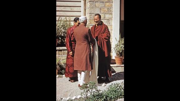 Indian Prime Minister Jawaharlal Nehru visits the Dalai Lama at the Birla House.
