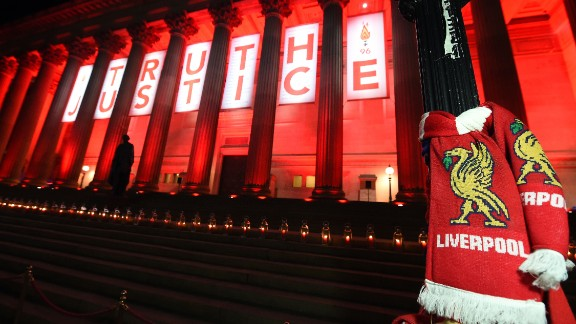 Candles adorn the steps of Liverpool