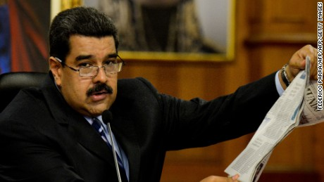 "Venezuelan President Nicolas Maduro reads a newspaper article during a press conference at the Miraflores presidential palace in Caracas on May 17, 2016. The army in crisis-hit Venezuela has to choose whether it is ""with the constitution or with (President Nicolas) Maduro,"" opposition leader Henrique Capriles said Tuesday. / AFP / FEDERICO PARRA        (Photo credit should read FEDERICO PARRA/AFP/Getty Images)"