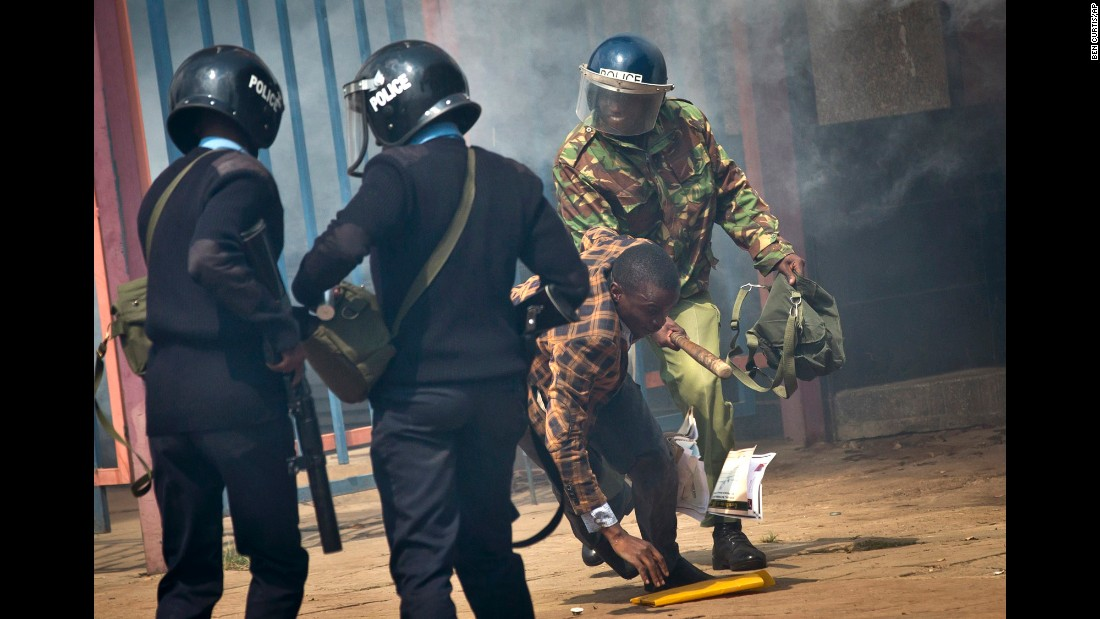 "An opposition supporter is beaten with a wooden club by riot police as he tries to flee. Kenyan police tear-gassed and beat opposition supporters <a href=""http://www.cnn.com/2016/05/17/africa/kenya-police-violence/"" target=""_blank"">during a protest</a> demanding the disbandment of the electoral authority over alleged bias and corruption."