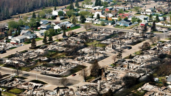 Remains of burned homes are seen in a neighborhood in Fort McMurray, Alberta, on Friday, May 13. A massive wildfire has forced more than 88,000 people from their homes.