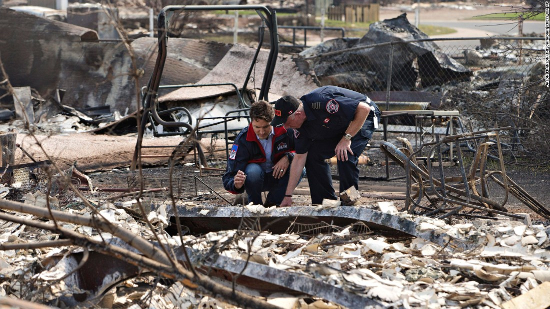 Canadian Prime Minister Justin Trudeau, left, and Fort McMurray Fire Chief Darby Allen look over the devastation during a visit to Fort McMurray on May 13.