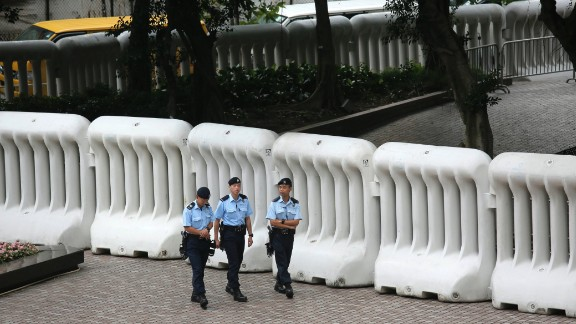 Huge crowd-control barriers were erected near the hotel where Zhang is staying. Thousands of police have been assigned to ensure any protests are quickly snuffed out.