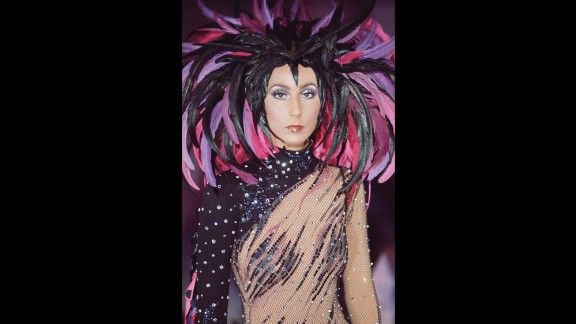 """Throughout her career, Cher has always been known for her flamboyant fashion. Here, she wears a feathered headdress for """"The Sonny and Cher Comedy Hour"""" in 1972."""
