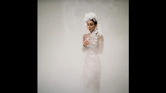 Cher sings in a cloud of fog during her show in 1972.