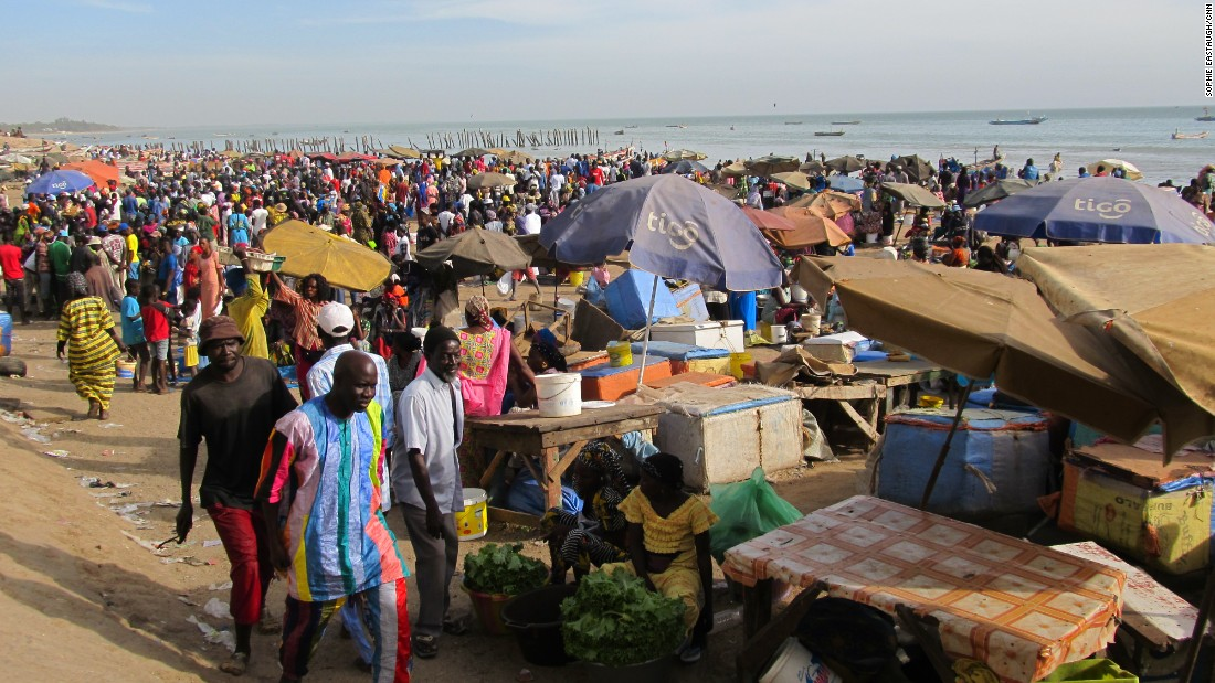 A rush of activity comes with the arrival of fishing boats in Mbour, just down the road from Saly.