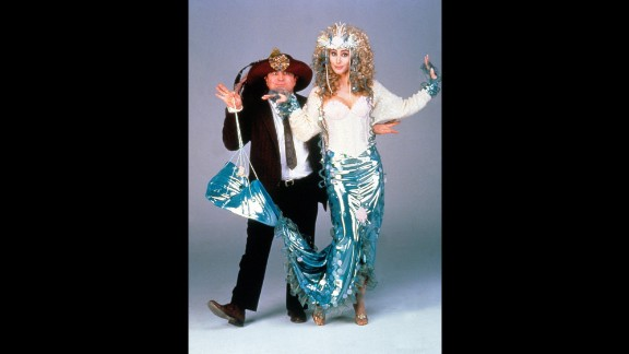 """Cher poses with actor Bob Hoskins to promote their 1990 film """"Mermaids."""""""