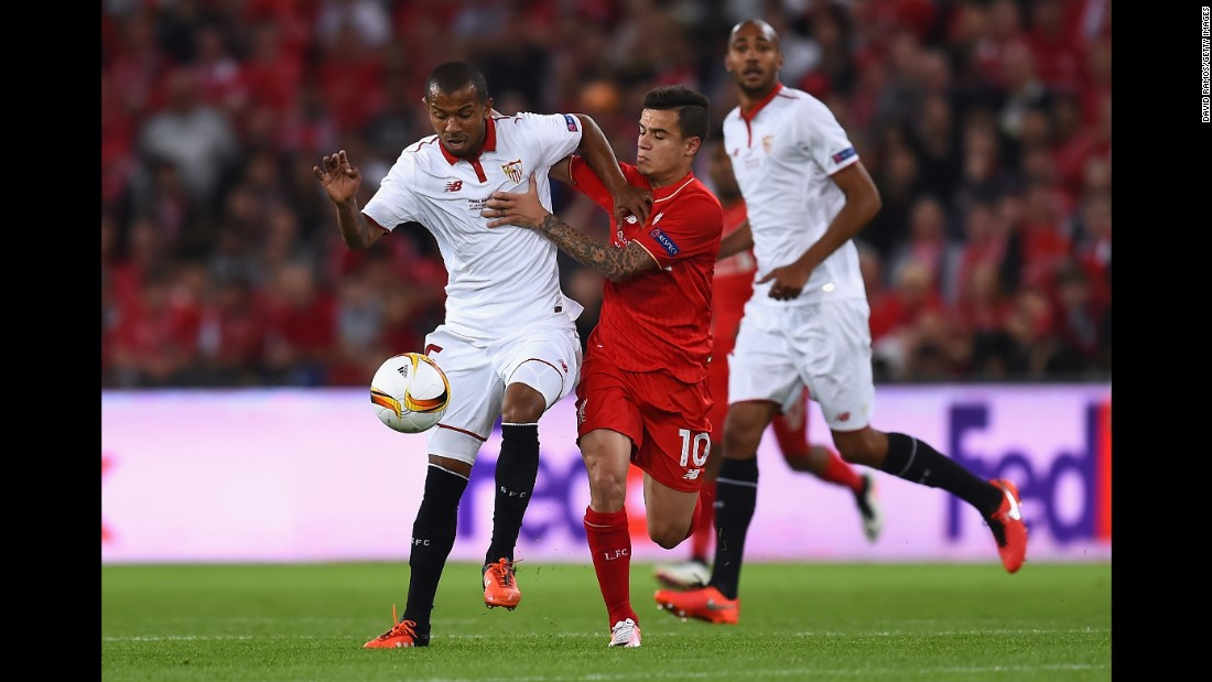 Sevilla's Mariano tries to fight off Liverpool's Philippe Coutinho.