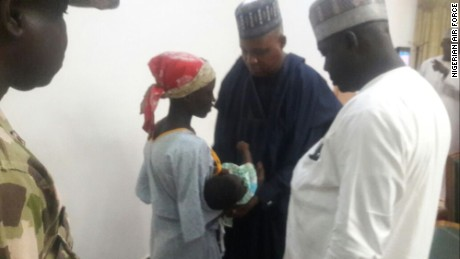 Chibok schoolgirl Amina Ali and her baby with Borno State Gov.  Kashim Shetima on Wednesday evening.