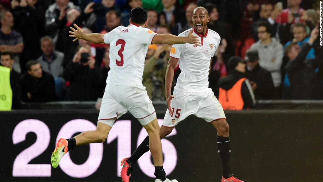 Sevilla's French defender Adil Rami (L) celebrates with fellow countryman and teammate Steven N'Zonzi on full time in Basel.