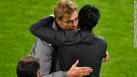 Sevilla coach, Unai Emery (R), hugs his Liverpool counterpart, Jurgen Klopp, after Sevilla won the Europa League final.