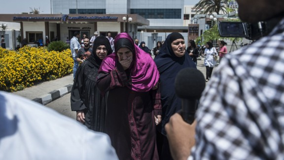 Family members of passengers who were flying aboard an EgyptAir MS804 get ready to be transported by bus to a gathering point at the Cairo airport in Egypt on Thursday, May 19.