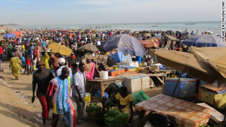 The daily throng as Mbour's fishing boats come in.