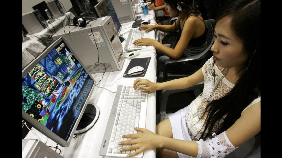 """In Korea, a """"PC Bang"""" -- where young gamers gather to play and """"train"""" -- can be located on almost every block."""
