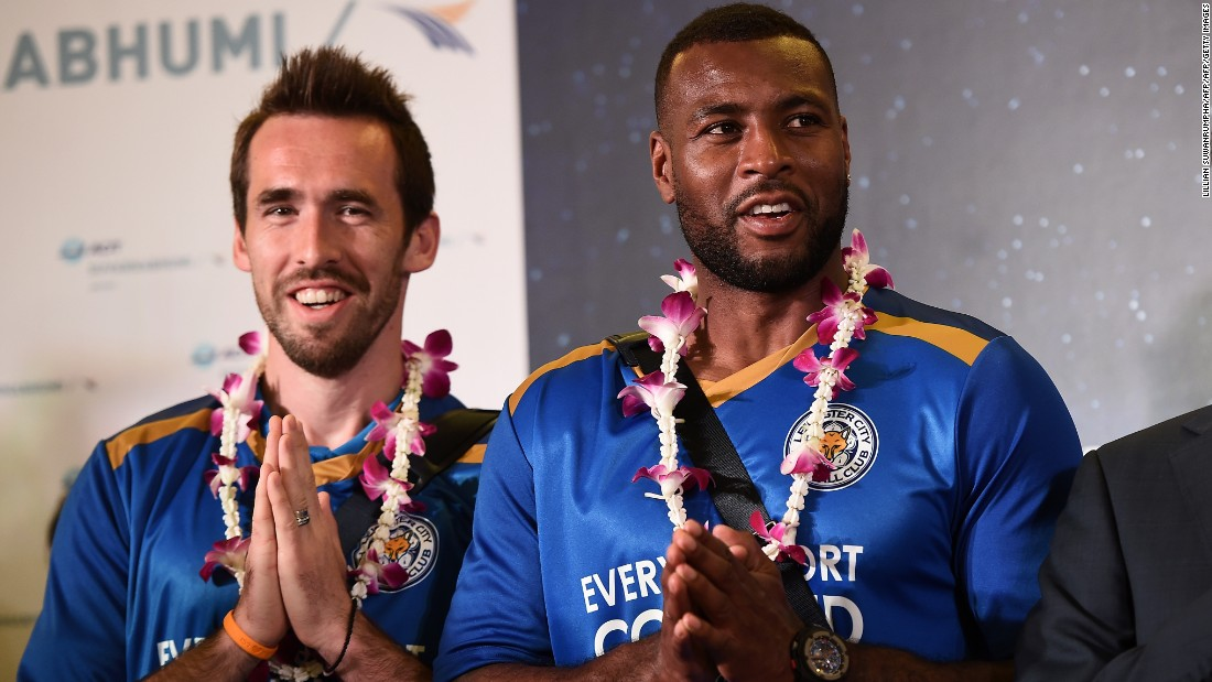 "Leicester defenders Christian Fuchs and Morgan, who is the team's captain, greet the press as the squad arrive at Suvarnabhumi Airport in Bangkok. Morgan said:  ""We're always extremely proud to come here and we know how much it means to the owners, who have done so much for the club in the last six years."""