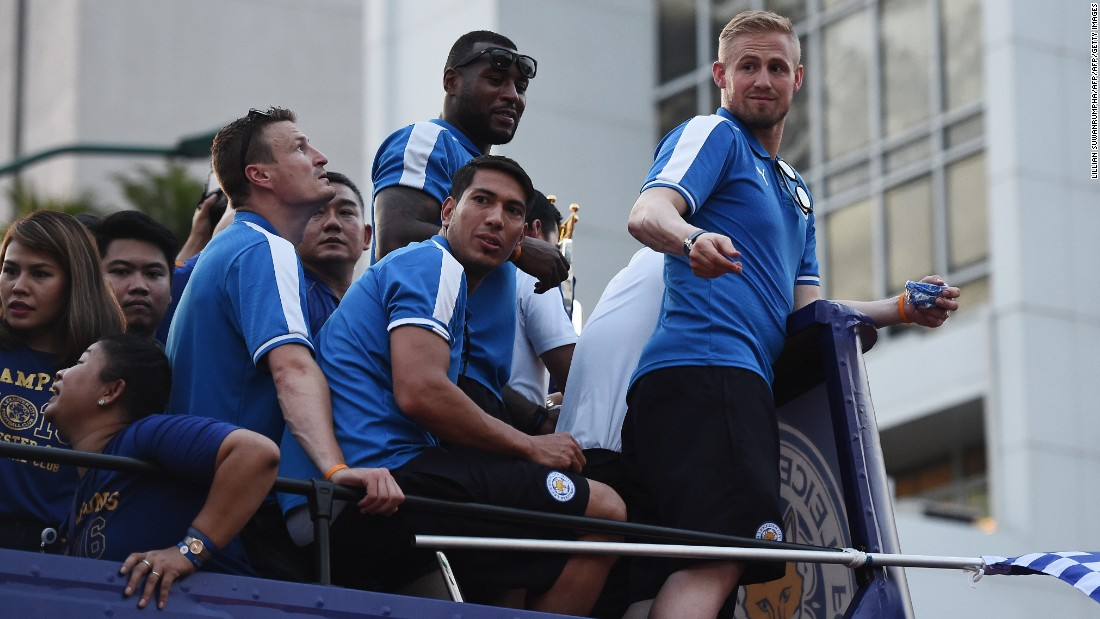 Leicester's Robert Huth (left), Wes Morgan (top center), Leonardo Ulloa (bottom center) and Kasper Schmeichel (right) take in the acclaim during the bus tour. Star striker Jamie Vardy and midfielder Danny Drinkwater were absent after international call-ups by England coach Roy Hodgson.