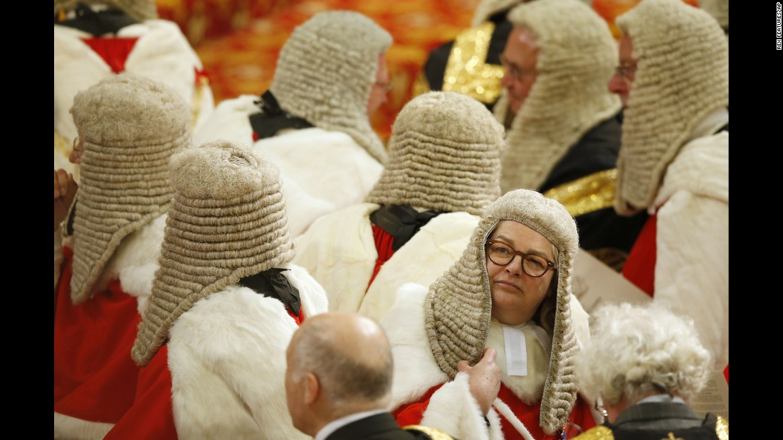 Members of the Law Lords, Britain's senior judiciary, take their seats as they wait for Queen Elizabeth II to speak at the opening of Parliament on Wednesday, May 18.