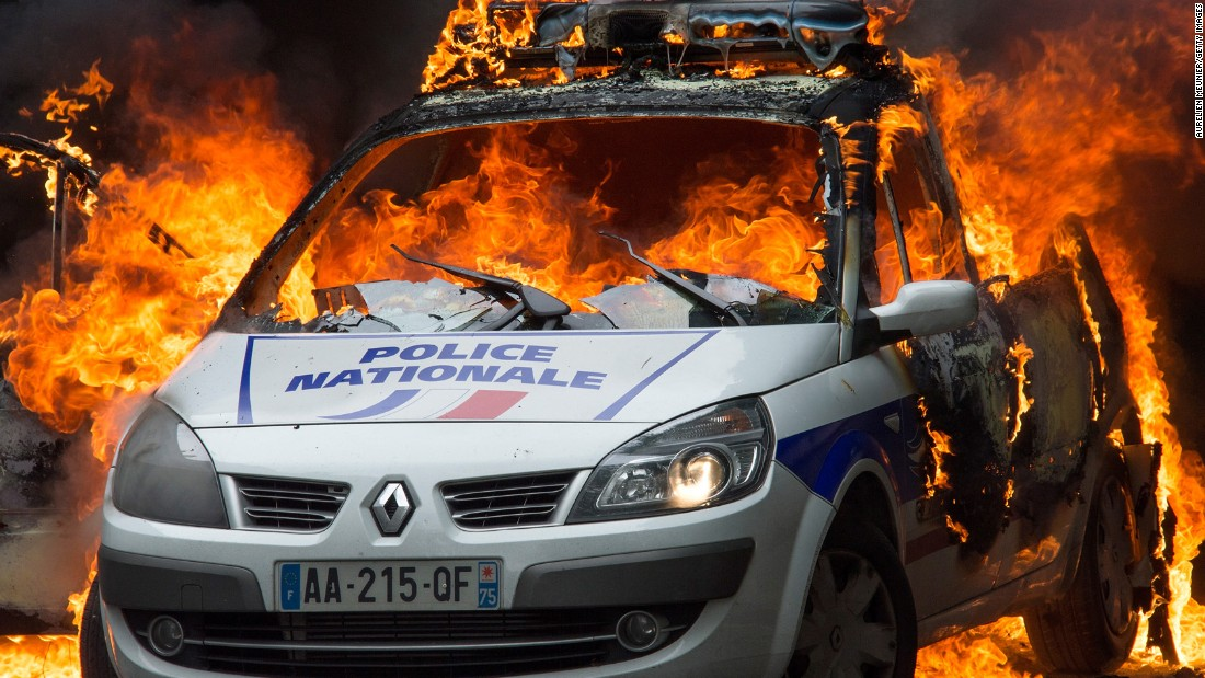 "A police car burns in Paris on Wednesday, May 18. Two officers <a href=""http://www.cnn.com/2016/05/18/europe/police-car-fire-paris-hatred-protest/"" target=""_blank"">escaped with minor injuries</a> after Molotov cocktails were thrown at their rear windshield, a police spokesperson said. The attack came on the same day that the national police union demonstrated against anti-police sentiment."