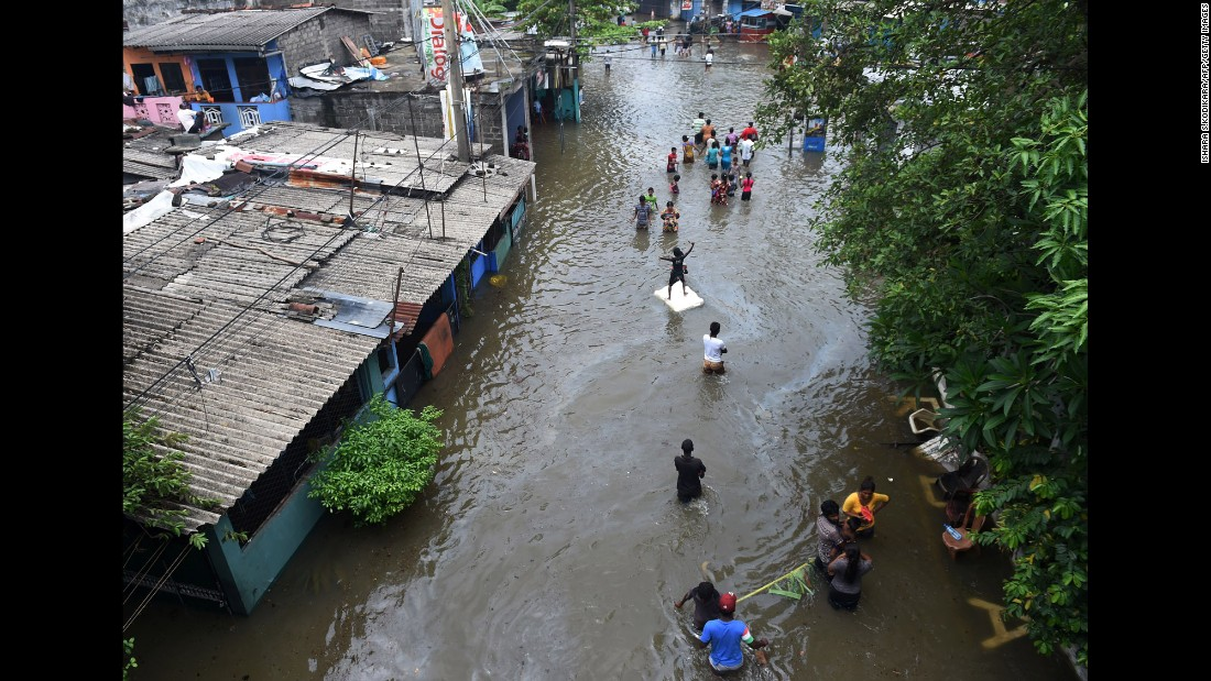 "Residents make their way through floodwaters in Colombo, Sri Lanka, on Thursday, May 19. Hundreds of thousands of people <a href=""http://www.cnn.com/2016/05/18/asia/sri-lanka-flood/"" target=""_blank"">have been forced from their homes</a> after a major storm hammered the country. At least 37 people have died and 21 are missing after three days of incessant rains that came just a couple weeks before the monsoon season."