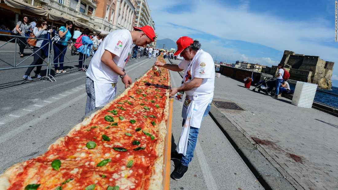 Pizza makers in Naples, Italy, help set a Guinness World Record for longest pizza on Wednesday, May 18. The wood-fired pizza was 6,082 feet long (1.15 miles).