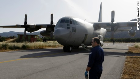 An engineer stands in front of a C-130 HAUP of the Hellenic Air Force, which took part in the searching operation of the missing Egypt plane, at the military air base of Kastelli on the southern Greek island of Crete, Friday, May 20, 2016.