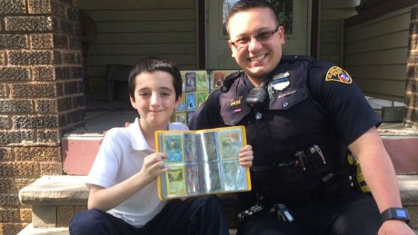 Jimmy Grotenrath and his new friend Bryce show off Bryce's expanded Pokemon collection