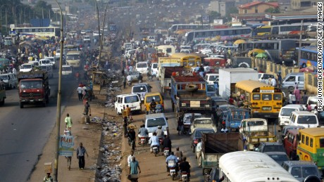 Motorists queue on Onitsha-Asaba highway 07 December 2005 at the burstling Onitsha motor park. Life returned to its usual frenetic pace in eastern Nigeria's main cities on 07 December 2005 as separatist militants declared a two-day protest a success, but at the cost of an unknown number of casualties. AFP PHOTO/ PIUS UTOMI EKPEI (Photo credit should read PIUS UTOMI EKPEI/AFP/Getty Images)