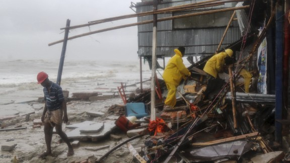 Rescue workers search for survivors after Cyclone Roanu hit Chittagong