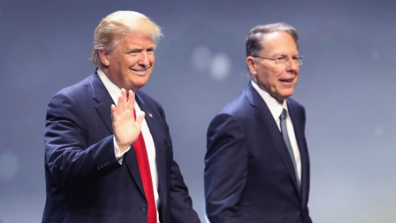 """Republican presidential candidate Donald Trump is introduced with Wayne LaPierre, executive vice president of the National Rifle Association, at the NRA national convention on Friday, May 20, in Louisville, Kentucky.  Trump presented himself as a fierce defender of the Second Amendment and attacked Hillary Clinton's stance on gun control. """"If she gets to appoint her judges, she will abolish the Second Amendment,"""" Trump told an enthusiastic crowd. """"In my opinion, that's what she's going to go for."""""""