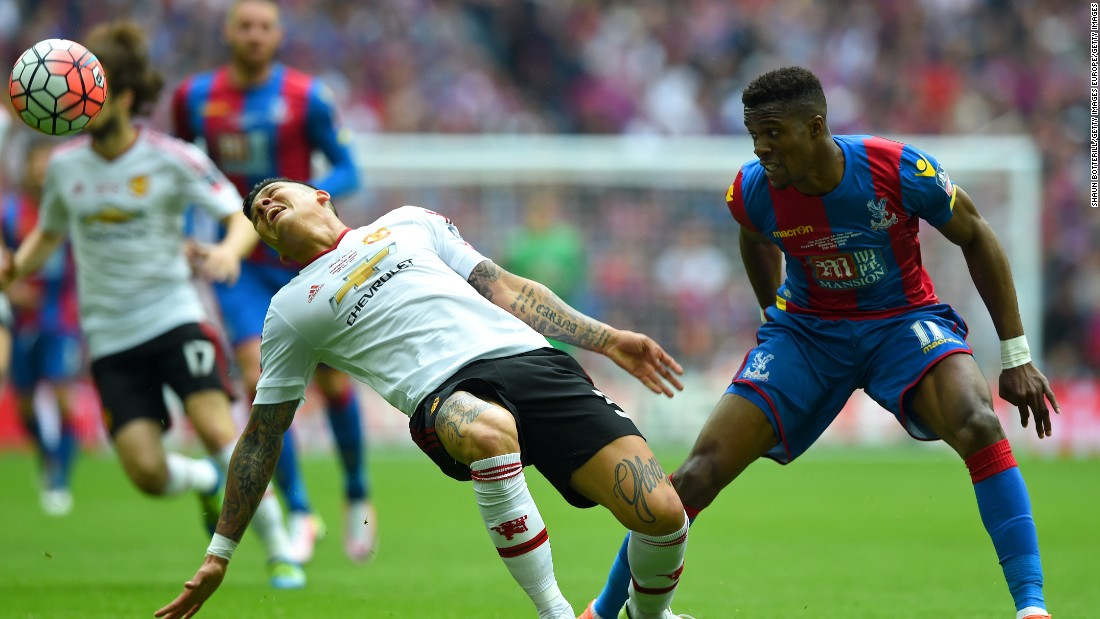 Marcos Rojo (R) gestures after coming into contact with Wilfried Zaha of Crystal Palace.