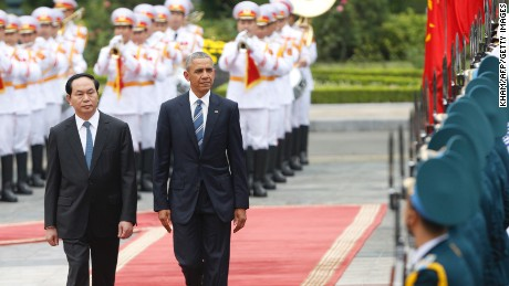 President Obama walks with his Vietnamese counterpart Tran Dai Quang as they review a guard of honour during a welcoming ceremony at the Presidential Palace in Hanoi, Vietnam on May 23, 2016.