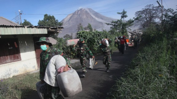 Indonesian soldiers carry people
