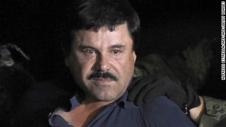 "Drug kingpin Joaquin ""El Chapo"" Guzman is escorted into a helicopter at Mexico City's airport on January 8, 2016"