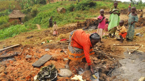 People displaced from their villages rummage through the ashes of their burnt homes in the North Kivu province in the Democratic Republic of the Congo (DRC) in February 2016. Around 20 people were killed and 40 wounded in one weekend