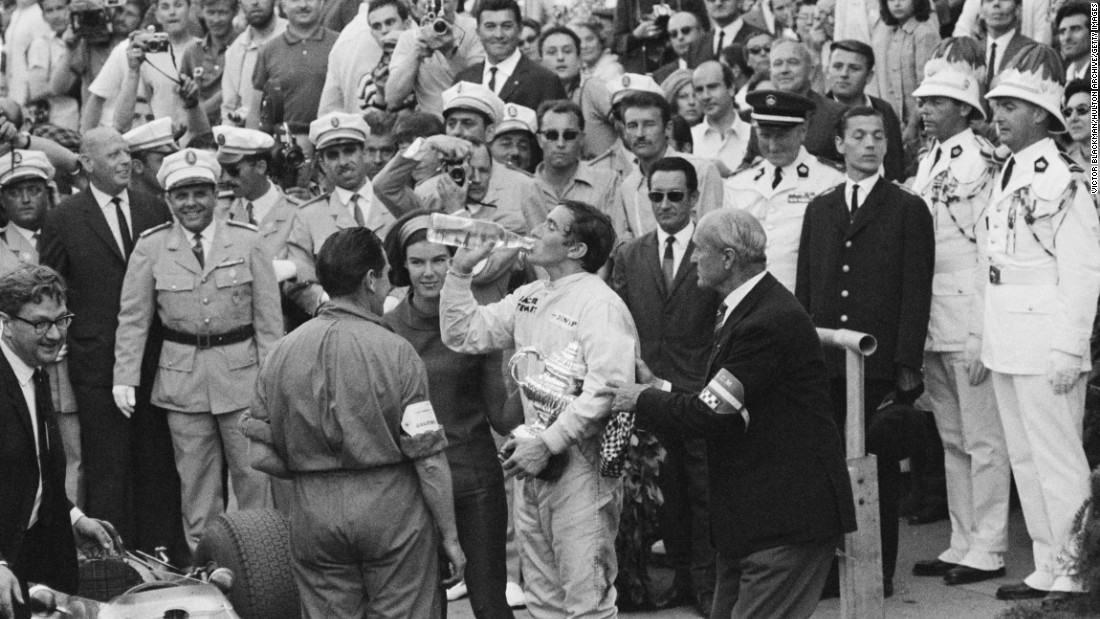 "Jackie Stewart refuels after winning the first of his three Monaco titles in 1966. Stewart began his F1 career partnering Hill at the BRM team. ""Graham was the man at that time and I learned a lot from him... it was a happy relationship -- he was a gentleman on the race track,"" Stewart told CNN."