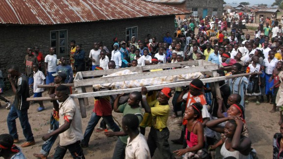 The violence is not new. Pictured, a burial procession for one of the victims of an attack on civilians near Beni, a large town in the North Kivu province, in April, 2015.