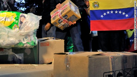 People arrange medical supplies and diapers donated during a campaign led by Lilian Tintori (not in frame), wife of Venezuela's jailed opposition leader Leopoldo Lopez, in Bogota, Colombia, on May 19, 2016.  Hundreds of people, mostly Venezuelans, donate medicines and supplies to send to their country, affected by a severe shortage of products. / AFP / GUILLERMO LEGARIA        (Photo credit should read GUILLERMO LEGARIA/AFP/Getty Images)
