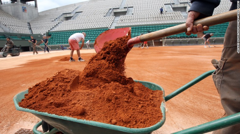 Employees set the last layer of clay on the Suzanne Lenglen court on May 7, 2012 at the Roland Garros tennis stadium in Paris, where the French Open tennis tournament will run from May 22 to June 10, 2012. AFP PHOTO JACQUES DEMARTHON        (Photo credit should read JACQUES DEMARTHON/AFP/GettyImages)